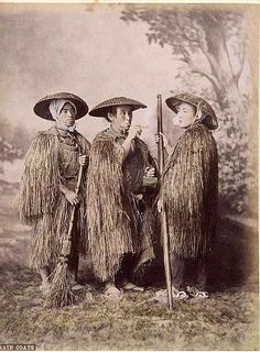 Wearing rain coats, 2nd half 19th century, via Flickr
