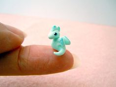Dragons can never be too big or too small...  Tiny dragon in light mint green  micro pocket by MijbilCreatures, $17.00