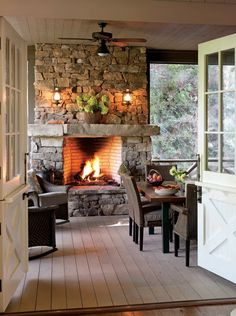 Who's ready for some autumn nights? This stone fireplace just makes us want to curl up by the fire. Where is your favorite mountain getaway spot? Get tons of cabin inspiration in our Southern Cottage special issue. Mountain Cottage, Lake Cottage, Cozy Cottage, French Cottage, Country French, Cottage Ideas, Low Country, Mountain View, Porch Fireplace