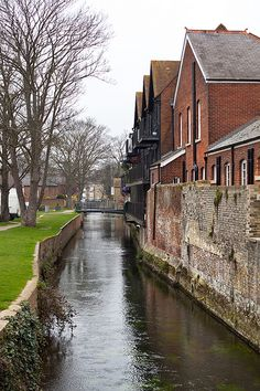 (L)  Crossing a small canal to enter Canterbury's high street.