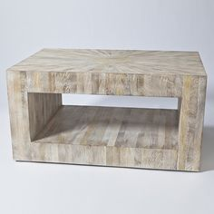 """Driftwood Coffee Table  35.25""""L x 23.5""""W x 18""""H  Insprired by the soft sandy hues of the seaside, the distinctive look of the Driftwood Collection is achieved by using individual precision-cut strips of mango wood. A sunburst pattern radiates from the center of the tabletop. Although a tour de force of carpentry, the effect is effortless and casual. To achieve this sun-bleached look, the piece is first lightened, then given a subtle creamy wash."""