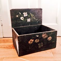 Painted rustic shelf box using Annie Sloan chalk paint ™ in Graphite, aged and decorated with flowers in Old White. Finished with dark wax. From FIND, Cows Lane. Temple Bar, Dublin.