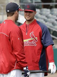 Matt Holliday talks with David Freese before a spring training game against the Nationals.  3-02-13