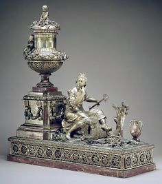 Mantel clock - Date: ca. 1780–90 Culture: probably Austrian Medium: Case: carved and gilded wood; Revolving rings for hours and minutes: gilded brass; Movement: brass and steel