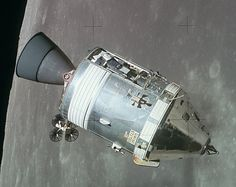 The cone-shaped Command Module, attached to the cylindrical Service Module…