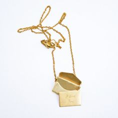 $30 - what???? a envelope necklace with an engraved card inside? I need this...