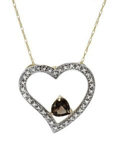 Dazzling Necklace Genuine Diamonds and topaz beautifully designed in 10K two tone gold. Total item weight 1.9g. Length 18 inch. Gemstone info: 1 topaz, 0.44ctw., heart shape and smoky color. 34 diamonds, 0.13ctw., round shape and H - J color. Clarity: I2.