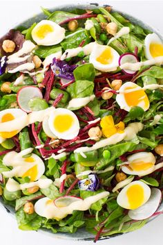 Sally Abé's English garden salad recipe is perfect for a light summer lunch, packed with asparagus, broad beans, peas, radishes and hazelnuts, this fresh salad is finished with delicate soft-boiled quails eggs and a homemade salad cream.