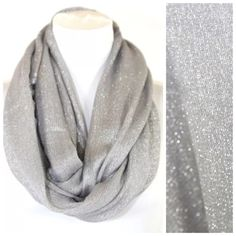 "B45 Metallic Lurex Glittery Silver Infinity Scarf Metallic Lurex Infinity Scarf ❌PRICE FIRM UNLESS BUNDLED❌  Photos do not do justice to this scarf (probably my poor photography skills).  It is really gorgeous & versatile.  Silver with metallic threading. 100% viscose. 25"" wide, 33"" long.  Please check my closet for many more items!!! Boutique Accessories Scarves & Wraps"