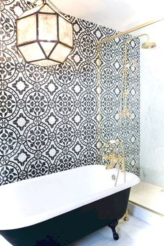 love the tub shower & tiles...the light fighting is touch bulky for the space.
