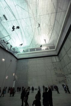 """On Space Time Foam, a floating structure composed of three levels of clear film that can be accessed by the public, inspired by the cubical configuration of the exhibition space,"" by Tomás Saraceno"