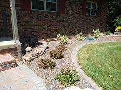 stone drystack wall/ twisty baby locust tree/ large brick paver