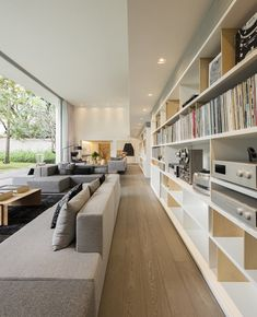 Polished Modern Interior With Dual Level Home Library - Modern Home Library Rooms, Home Library Design, Home Libraries, Home Office Design, Modern House Design, Modern Interior Design, Library Bar, Modern Library, Modern Houses
