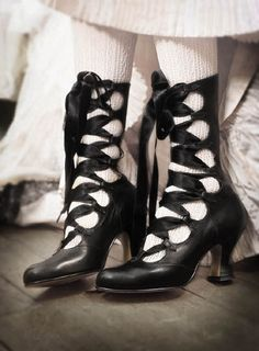 I'm looking at these boots and thinking, how hard would this be to do with a pair of old boots? Cut, make loops, stitch down, lace with ribbon...