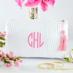 Monogrammed cosmetic bags make cute personalized bridesmaid gifts. These monogrammed cosmetic bags With Tassel are super cute!