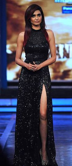 Beautiful long black gown with shimmer and slit: Indian Bollywood and TV actor Karishma Tanna poses for a photograph during the 'Bigg Boss Seaon 8' final in Lonavala on late January 31 2015 AFP PHOTO/STR #gown #gowns Bollywood Fashion #karishmatanna #bollywood #bollywoodfashion #celebfashion #celebrities Cocktail Dress, #cocktaildress @gettyimages via @sunjayjk