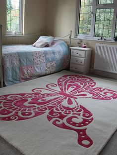 Contemporary and Beautiful Pink Butterfly Rug Design for Home Flooring by Anna V Rugs  Pinned for Kidfolio, the parenting mobile app that makes sharing a snap