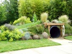 Hobbit house for children's garden is part of children Playing Landscape - A cozy Hobbitsized house for the children to run through and roll over Photo Clare Hancock Natural Playground, Backyard Playground, Playground Kids, Backyard Fort, Backyard Ideas, Backyard Dog Area, Rustic Backyard, Outdoor Play Spaces, Outdoor Fun