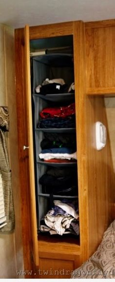 Use hanging organizer in cabinets.