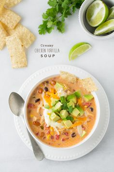Make this creative creamy chicken tortilla soup in one pot for a quickly ready, flavorful dinner, filled with spices, beans, chicken, and sour cream.