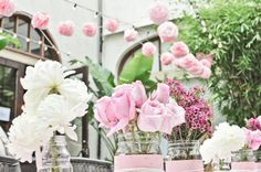 Pink #bridal #shower- love the flowers in variations of pink and the hanging poms are adorable