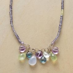 COOL COLORS NECKLACE -- Anne Sportun collects cool-colored gems of amethyst, prehnite, London blue topaz, chalcedony and aquamarine. Peridot-sparked iolite strand with 18kt white gold. Handcrafted. Exclusive. 16L.