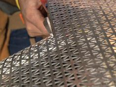 Cutting aluminum material used to make a radiator cover.