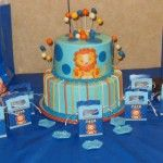 Lion baby shower theme helped Hostess Hero Crystal create this adorable boy baby shower. Lion baby shower mini favor boxes circled the amazing cake at the gift table, welcoming each guest. Crystal also gave everyone the opportunity to participate in the Blue Dirty Diaper baby shower game – always a crowd favorite – by laying