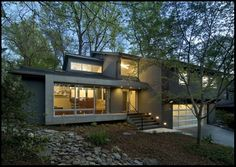 """{by KUBE architecture} """"Complete interior renovation of a 1980s split level house in the Virginia... suite. New front elevation at entry, new rear deck and complete re-cladding of the... house. Interior: The prototypical layout of the split level home tends to separate... one half level up. In this home the lower level """"living"""" room off the entry was... entry of the house was a fragmented composition of disparate elements. The rear of... use multi leveled deck."""""""