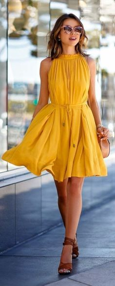 Yellow is such a sunshine colour and looks great on this beautiful flowing summer dress. Teamed with natural tan leather heeled sandals, it's the perfect summer look for fashionable women.