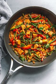 Thai Red Curry Tofu - aromatic and flavorful Thai red curry tofu is vegetable-forward, comes together quickly, and tastes better than take-out. Dairy and gluten free. #abeautifulplate #recipe #curry #Thai #tofu #dairyfree #glutenfree #dinner #recipe