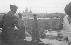 Woman of the firefighter regiment on duty on the roof of the Winter Palace in Leningrad [Via]