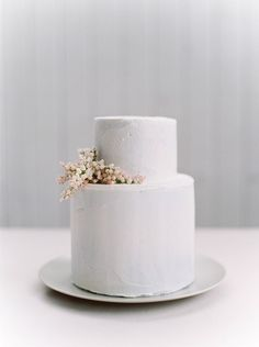 Simple and modern all white wedding cake.