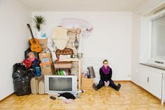 """Gothemburg-based photographer Sannah Kvist created a collection of photographs entitled """"All I Own"""" where Swedish students were pictured with sculptures made from all their possessions. The result makes us question what we really need for living, if we are buying too much crap, and if it's true that less stuff leads us to more freedom."""