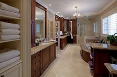 Middle entry doors, split vanities, corner make-up vanity, corner shower, etc...