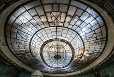 French photographer Romain Veillon, 30, has spent the last two years exploring abandoned facilities in Europe. One striking set takes us into the century-old control room of Budapest's Kelenföld Power Plant.  Read more: http://www.businessinsider.com/budapests-kelenfld-power-plant-photos-2013-12#ixzz2odZr6pBC
