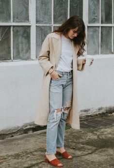 Beige trench coat, white t-shirt, pale blue jeans & rusty red slides | @styleminimalism