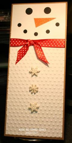 By Connie Jones (stamp300 at Splitcoaststampers). Cute card for winter! Bottom part dry embossed in a dots embossing folder. Eyes & mouth dots are punched. Nose is hand cut (Cut a rectangle with paper cutter; then cut corner to corner.) Buttons are purchased embellishments. Add ribbon & card base.