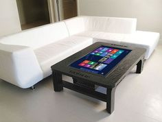 This high tech touchscreen coffee table would surely impress you visiting guests. You can surf the internet, browse photo, play games and etc on it. It's a full fledged pc built into a table!