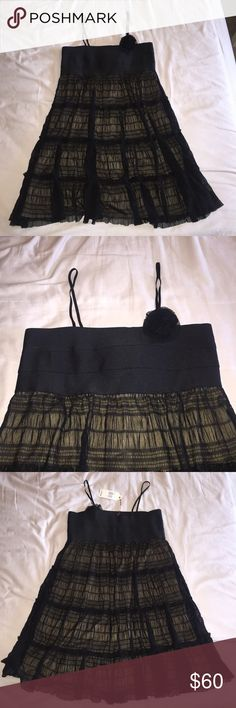 NWT Little Black Dress From Max Studios Specialty Products (M.S.S.P.) in size Large, never worn and tag still attached.  All black lace bottom with detached nude rayon/spandex lining; top is bandage dress material so super stretchy with non-detachable mesh flower.  Thin, bra-like adjustable straps.  Extremely flattering style, just never got to wear it. Max Studio Dresses Mini