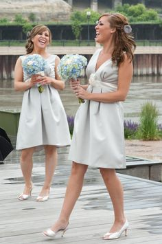 Bridesmais dresses, short and cute, and the flowers are a perfect match with them.