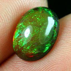 Ethiopian Opal   Black Opal Fire Opal   cabochon by CoyoteRainbow