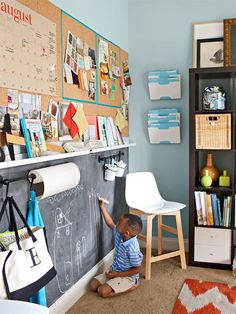 With storage needs accommodated elsewhere in this combination office/playroom, the homeowners were free to introduce a bit of practical play into their one-wall makeover. To delineate kid space from adult space, a center narrow shelf divides the two. Corkboard up top equals room for a calendar, design swatches, and more; a chalkboard and hooks below offer kid-friendly drawing space.