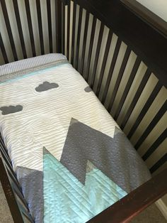 Love the mountains? Then youll love this beautiful crib quilt. Its the perfect compliment to any rustic, woodland, or outdoor themed nursery. Finished, it measures approx 40x50 fitting a standard crib mattress. Its a generous size for a newborn but offers years of snuggling and use as baby grows. This quilt is handmade using only the highest quality cotton fabrics and batting. It will be professionally longarm quilted for durability to last for years. Great texture has been created…