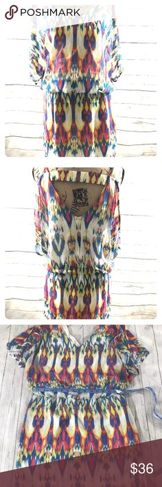 "Multi color Aztec shorts romper sz 12 Like new condition Bisou Bisou shorts romper. Flirty boho chic with class. Semi open back peek a boo strap near neckline. Just a tad too large for me as I am working my way back to a size 8-10, but does still fit loosely and I'm 42-43"" bust depending on bra. True to size. 12-14 maybe even. Absolutely beautiful bright colors lined light flowy fabric. I have a couple more B.B. 2list  * Size:  12  * Measurements Flat Across *(Can be off by 1/2"")…"