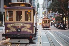 Cable cars on city street, San Francisco, California, USA - Wonwoo Lee / Getty Images