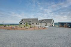 Exterior and driveway - New custom home designed and built by Quail Homes of Vancouver Washington.