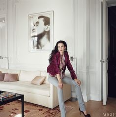 Personal Touch - The designer, in her own clothing and jewels, perched in the paneled drawing room beneath an Andy Warhol print of John Giorno in the 1963 film Sleep. Har, Frédéric Barat for Leonor Greyl; makeup, Sandrine Cano.