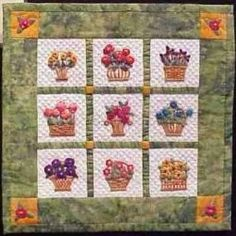 If you have never made a Miniature Quilt, why not try one for a change of pace? You can make a miniature quilt for a dollhouse bed or larger doll cradle, a decorative wall-hanging for the holidays, or even a lap quilt or small throw to match your furnishings.    The miniature quilt shown to the left is 8 1/2 inches square and is appliqued and embellished with embroidered details.