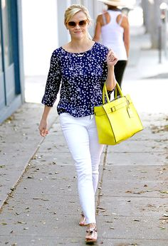 """Reese Witherspoon has been spotted out on multiple occasions toting a bright bag we just can't get enough of: Reed Krakoff's lemon-hued """"RK40L"""" tote, which retails for a cool $2,700. Steal her style!"""